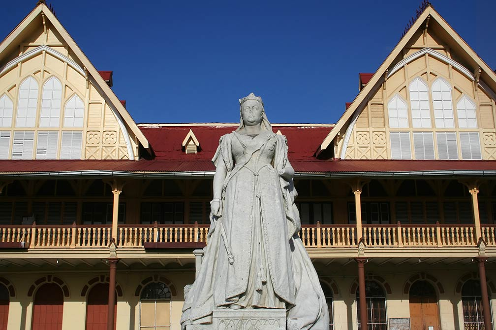Courthouse in Georgetown, Guyana with a Statue of Queen Victoria