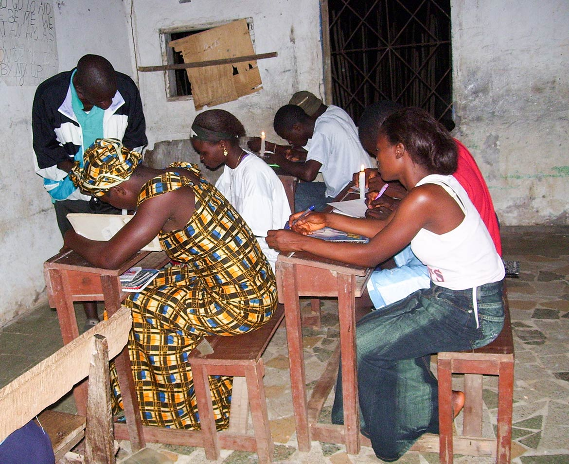 Students studying by candlelight in Bong County in Liberia