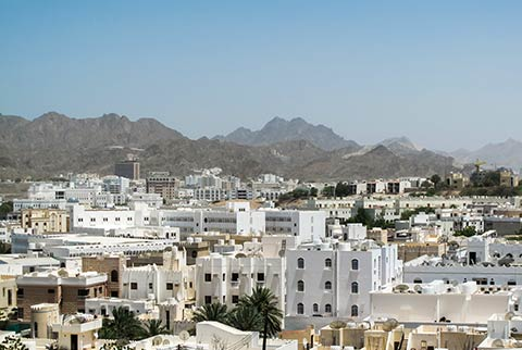 how to call muscat from india