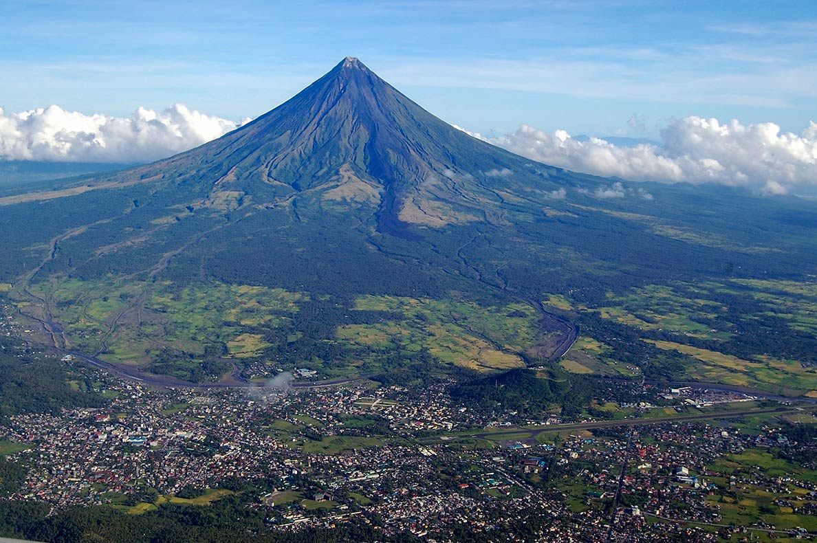 Mount Mayon and the city of Legazpi on the island of Luzon