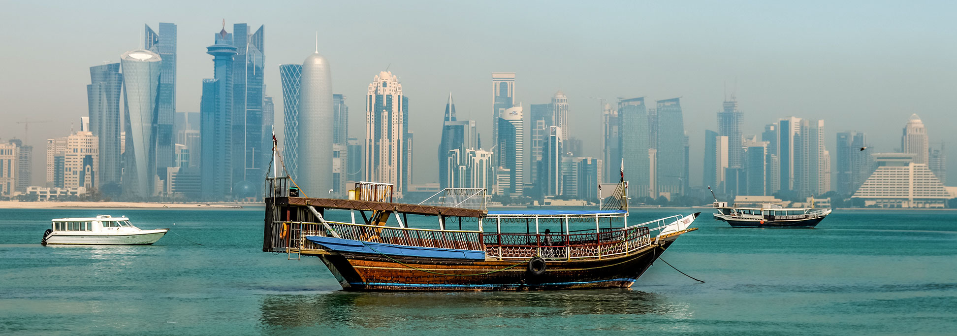 Doha skyline with Dhow.