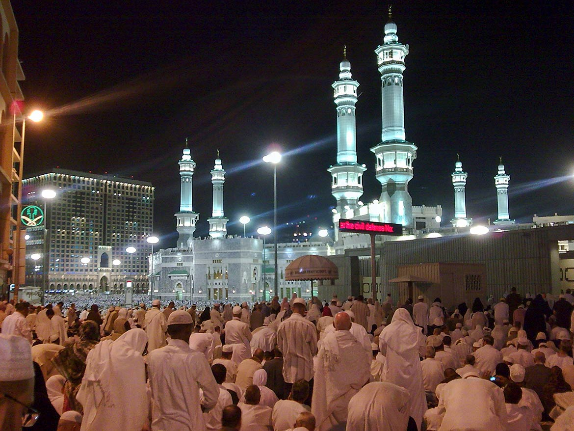 Praying men at Masjid ul Haram, the Great Mosque of Mecca
