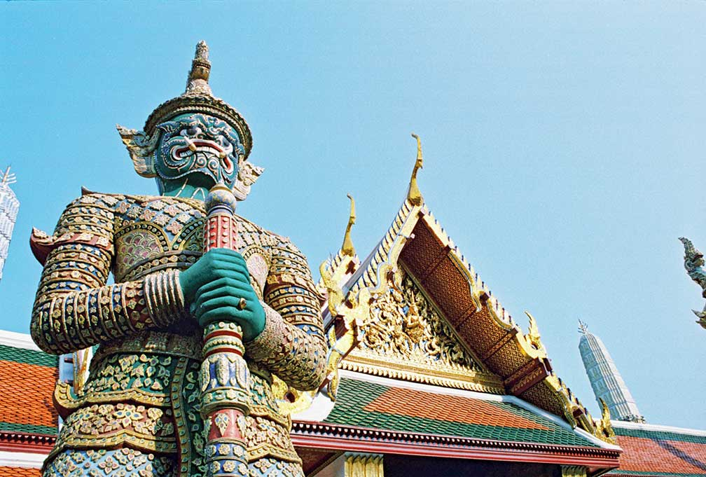 Giant demon (Yaksha) guarding an exit to Grand Palace in Wat Phra Kaew, Bangkok