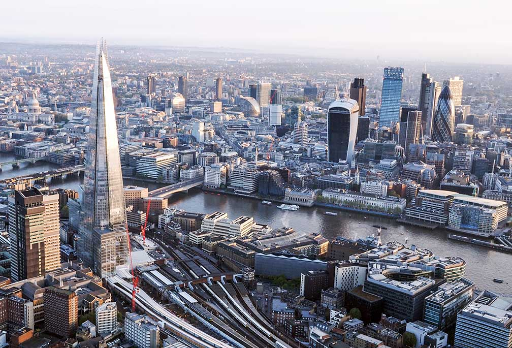 Central London seen from a hot air balloon, with River Thames, the Gherkin, the Shard, and London Bridge station