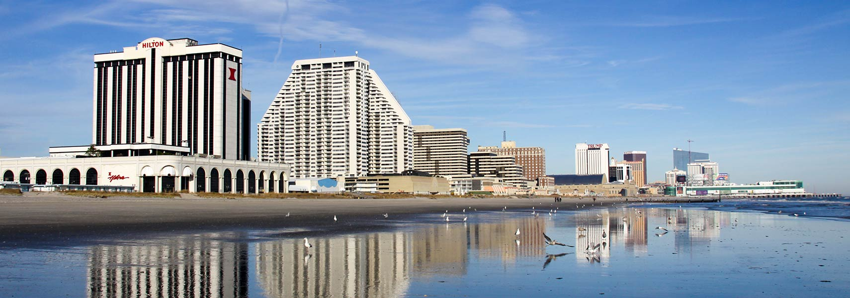 Casinos reflected on the sand in Atlantic City, NJ
