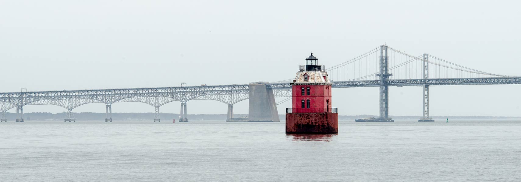 Chesapeake Bay Bridge over the Chesapeake Bay with Sandy Point Shoal Lighthouse