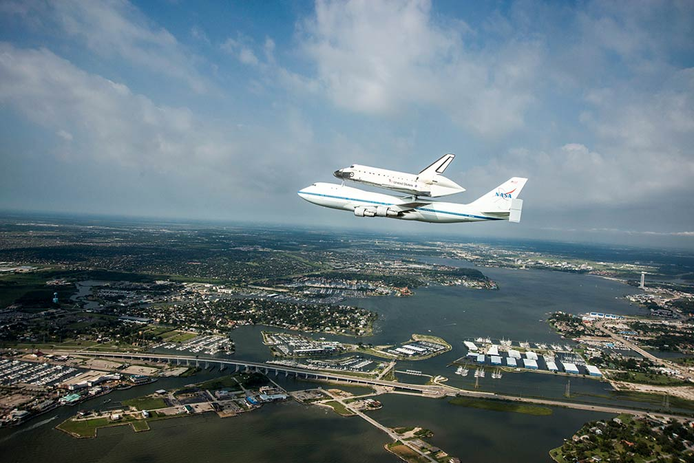 Space Shuttle Endeavour is ferried by NASA's Shuttle Carrier Aircraft over  Housten, Texas