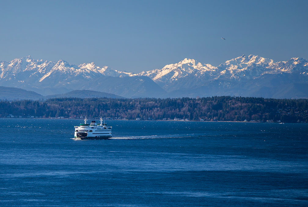 Ferry on Puget Sound with Cascade Mountain Range in Washington State