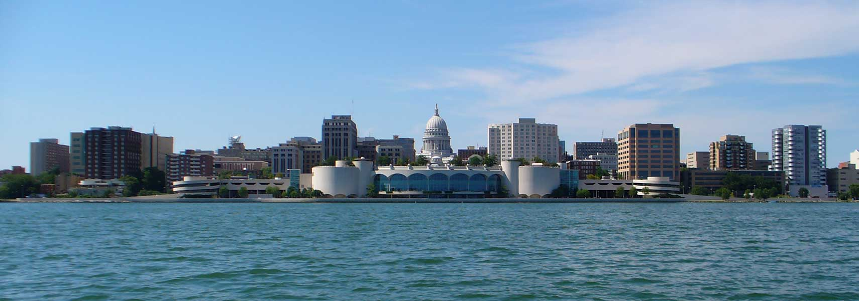 Skyline of Madison, Wisconsin as seen from Lake Monona. Monona Terrace in center