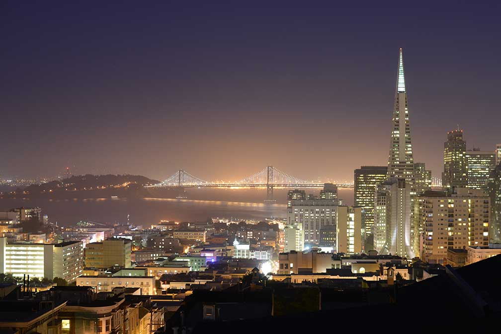 San Francisco-Oakland Bay Bridge in background, and the Transamerica Pyramid in San Francisco, California, USA
