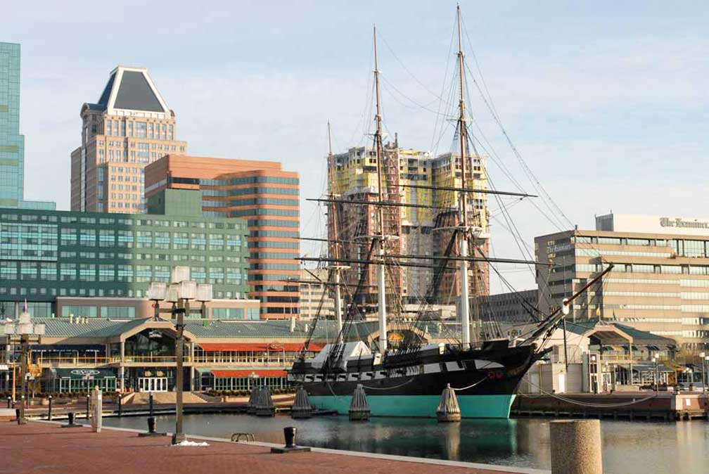 baltimore harborplace with uss constellation in downtown baltimore maryland usa