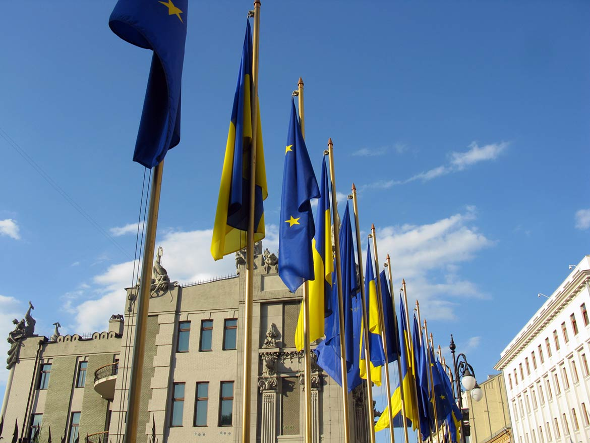 Flags of Ukraine and the European Union in front of the House with Chimaeras, Kyiv