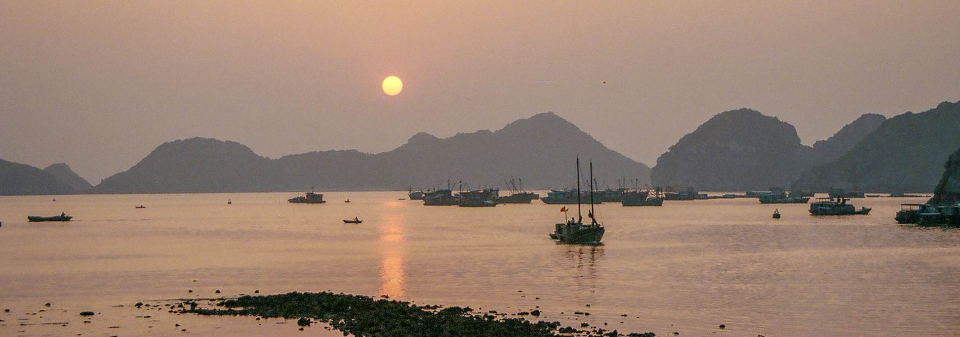Sunset at Halong Bay from Cat Ba Island in Vietnam