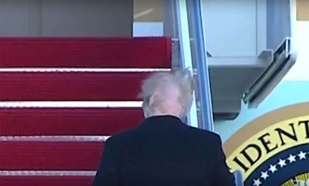 The US President with wind blown hairdo
